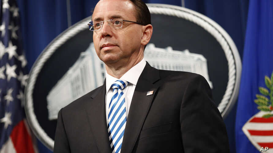 Deputy Attorney General Rod Rosenstein listens was Attorney General William Barr speaks about the release of a redacted version of special counsel Robert Mueller's report during a news conference, April 18, 2019, at the Department of Justice in Washi...