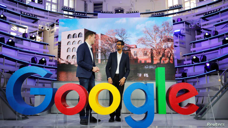 FILE - Google CEO Sundar Pichai (R) and Philipp Justus, Google Vice President for Central Europe and the German-speaking Countries, attend the opening of the new Alphabet's Google Berlin office in Berlin, Germany, Jan. 22, 2019.