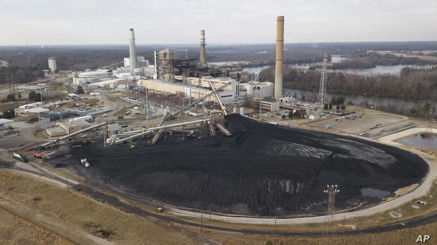 A large field of coal is stored on the property of Dominon Energy's Chesterfield Power station in Chester, Virginia.,  Dec. 4, 2017. The station is a coal fired power station along the James River. Chesterfield Power Station