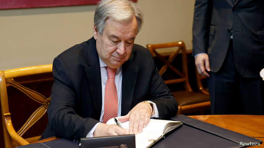 U.N. Secretary-General Antonio Guterres signs the WTO's golden book prior to the U.N. Secretary-General addressing to Special Session of the WTO's General Council, in Geneva, Switzerland, May 10, 2019.