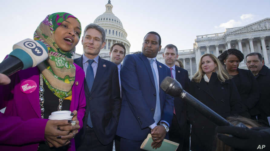 FILE - Rep. Ilhan Omar, D-Minn., left, Rep. Mike Levin, D-Calif., Rep. Christopher Pappas, D-N.H., Rep. Joe Neguse, D-Colo., and other freshmen member of the House of Representatives speak on Capitol Hill.