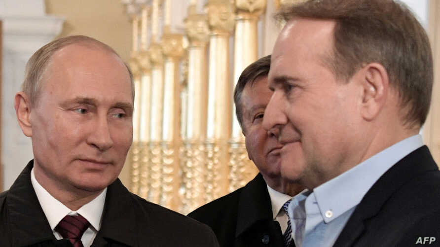 FILE - Ukrainian politician Viktor Medvedchuk, right, is pictured with Russian President Vladimir Putin at the New Jerusalem Orthodox Monastery outside the town of Istra, 70 from Moscow, Nov. 15, 2017.
