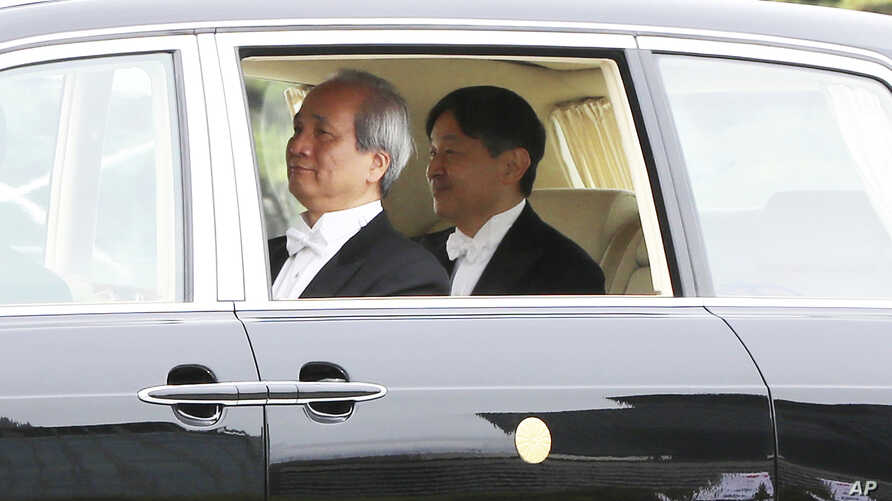 Japan's new Emperor Naruhito leaves the Imperial Palace Wednesday, May 1, 2019, in Tokyo.