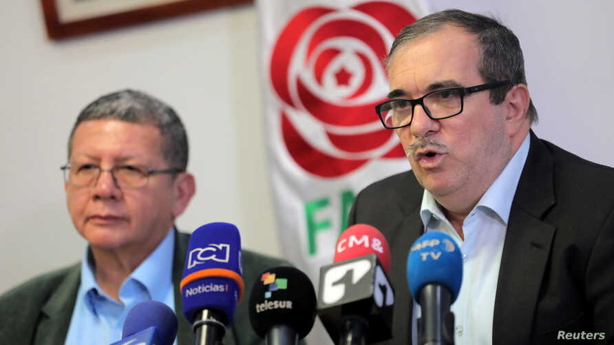 Former rebel leader of Colomobia's Revolutionary Armed Forces of Colombia (FARC) Rodrigo Londono (R), known by his nom de guerre Timochenko, and Pablo Catatumbo, former FARC commander and now member of the political party Revolutionary Alternative Co...