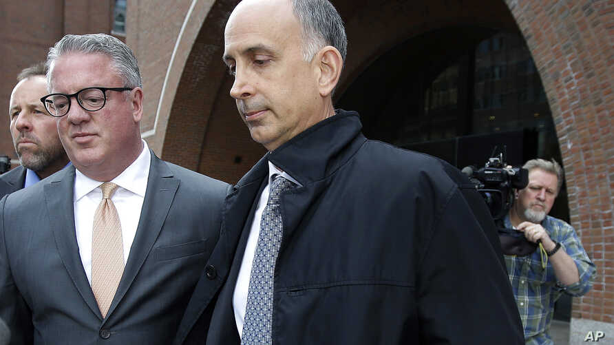 California businessman Stephen Semprevivo departs federal court,  May 7, 2019, in Boston, after pleading guilty to charges that he bribed the Georgetown tennis coach to get his son admitted to the school.