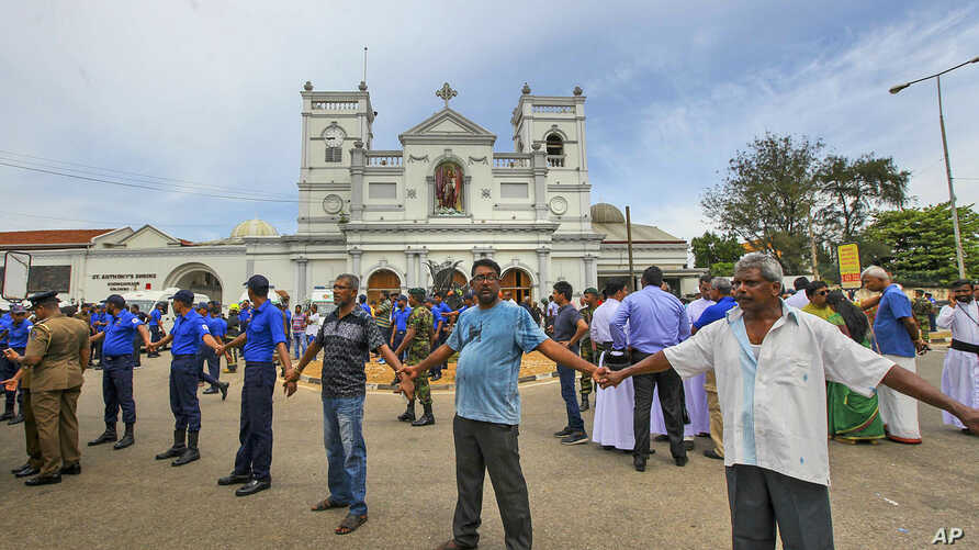 Sri Lankan soldiers secure the area around St. Anthony's Shrine, April 21, 2019, after a blast in Colombo, Sri Lanka.