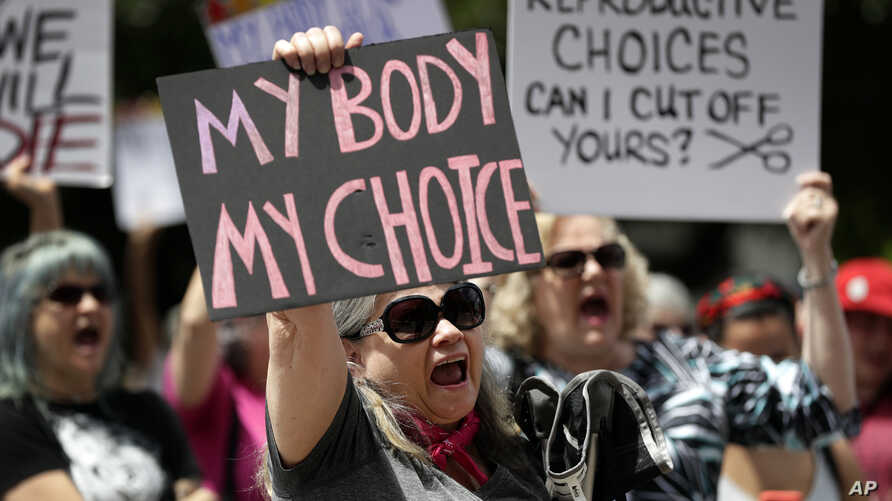 A group gathers to protest abortion restrictions at the State Capitol in Austin, Texas, May 21, 2019.