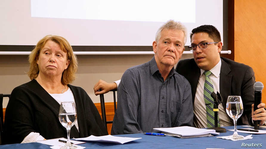 Gorel Biniel (L) and Dag Gustafsson (C), parents of Swedish software developer Ola Bini, and lawyer Carlos Soria, hold a news conference after a local judge ordered Bini jailed pending trial for alleged involvement in hacking government computer syst...