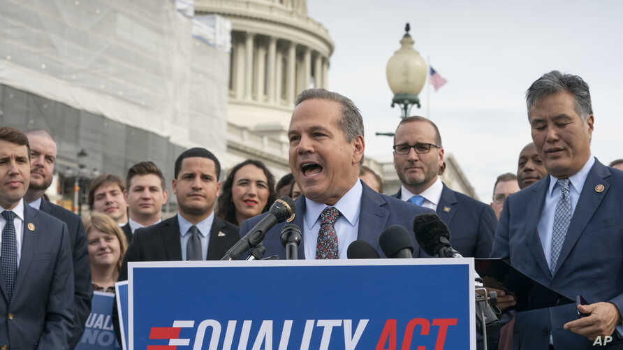 Rep. David Cicilline, D-R.I., joined at right by Chad Griffin, president of the Human Rights Campaign, and Rep. Mark Takano, D-Calif., speaks before a House vote on the Equality Act of 2019, which would extend anti-discrimination protections to LGBT ...
