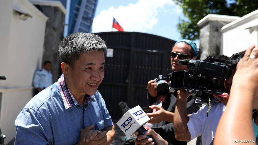"A Taiwanese citizen identified only as ""William"" speaks with the media outside the Taiwan embassy on August 21, 2018."