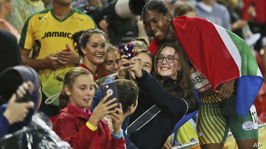 South Africa's Caster Semenya takes a selfie with fans after winning gold in the women's 1500m final at Carrara Stadium during the Commonwealth Games on the Gold Coast, Australia,  April 10, 2018.