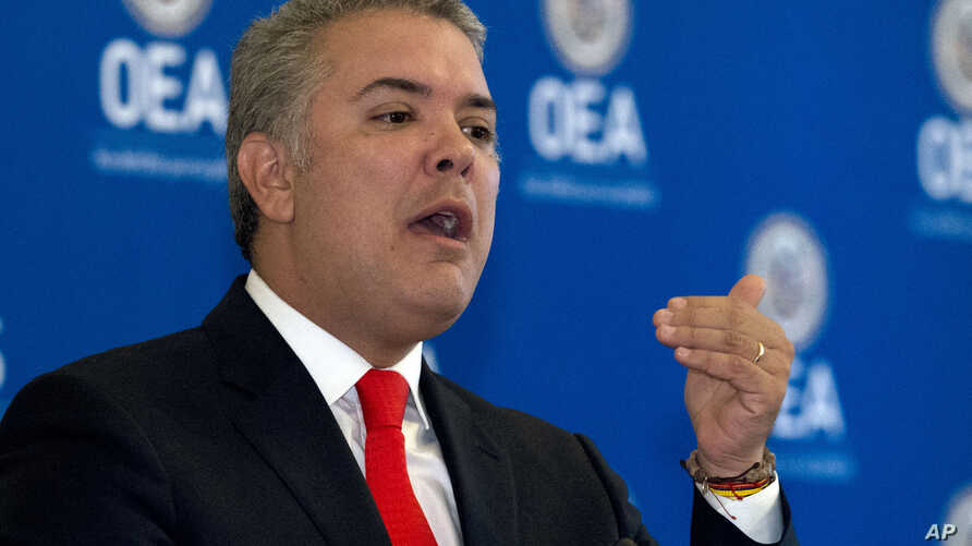 Colombian President Ivan Duque addresses the Organization of American States Permanent Council during an official visit at OAS's headquarters in Washington, Feb. 15, 2019.