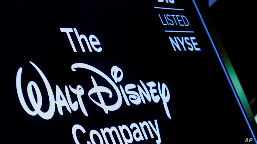 FILE PHOTO: A screen shows the logo and a ticker symbol for The Walt Disney Company on the floor of the New York Stock Exchange in New York, Dec. 14, 2017.