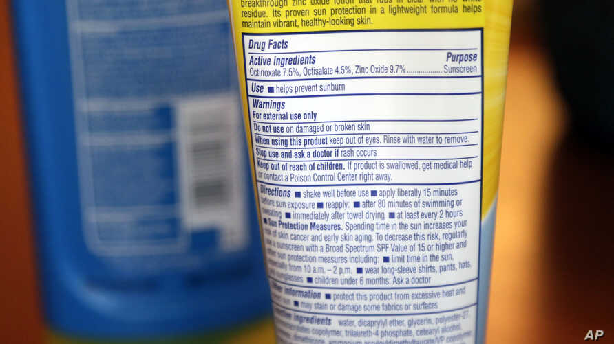 FILE - Sunscreen ingredients, including octinoxate, are shown May 2, 2018, in San Jose, Calif.