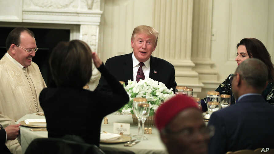President Donald Trump joins an iftar dinner, which breaks a daylong fast, celebrating Islam's holy month of Ramadan, in the State Dining Room of the White House in Washington, Monday, May 13, 2019.