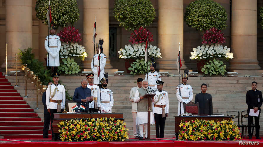 India's President Ram Nath Kovind administers Amit Shah's oath of office during a swearing-in ceremony at the presidential palace in New Delhi, India, May 30, 2019.