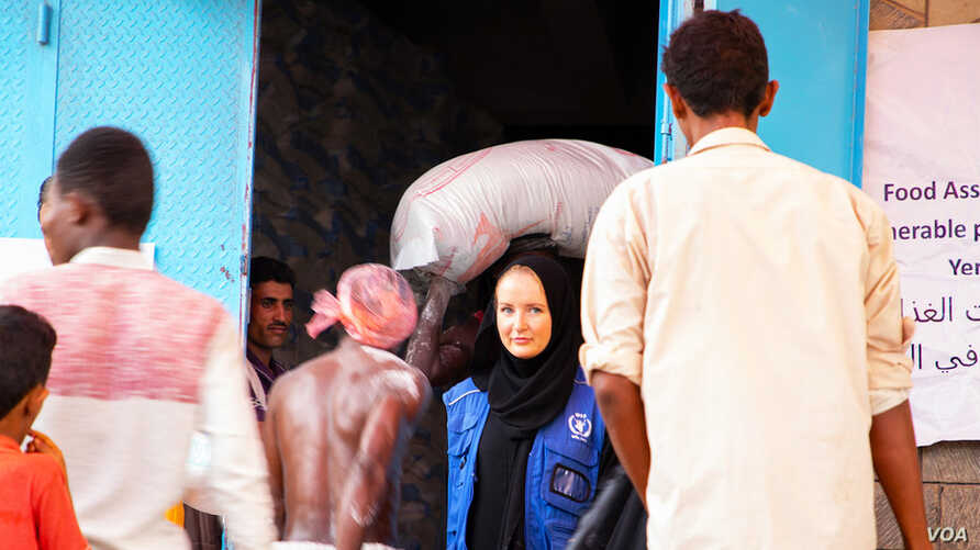 FILE - People in the Yemeni port city of Hudaydah have been provided with vouchers by the World Food Programme which they can exchange for food. (March 2019)