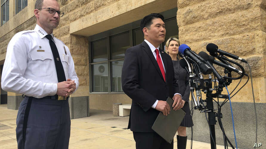 From left to right, Prince George's County Police Chief Henry Stawinski, U.S. Attorney Robert Hur, of the District of Maryland, and Jennifer Moore, Baltimore special agent, address reporters April 9, 2019, outside the federal courthouse in Greenbel...