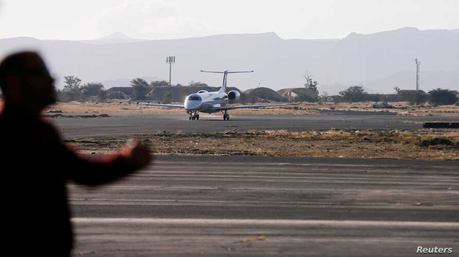 FILE - A plane carrying members of a United Nations team arrives at Sanaa airport, Yemen, Dec. 22, 2018. The Saudi-led coalition attack a nearby air base, May 1, 2019.