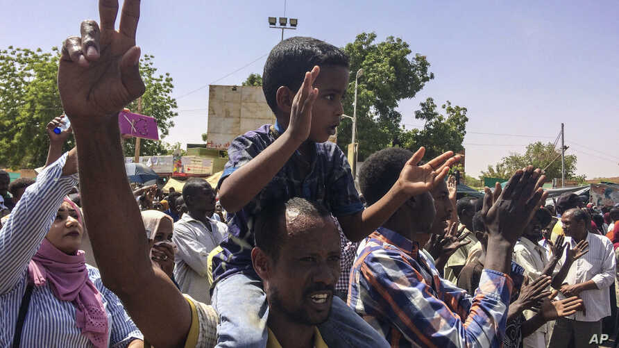 Protesters rally at a demonstration near the military headquarters, April 9, 2019, in the capital Khartoum, Sudan. Activists behind anti-government protests in Sudan say security forces have killed at least seven people.