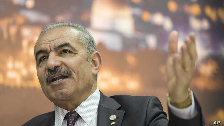 Palestinian Prime Minister Mohammad Shtayyeh italks during an interview with The Associated Press, at his office in the West Bank city of Ramallah, April 16, 2019.