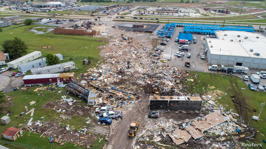 A path of destruction through the American Budget Value Inn and Skyview Mobile Park Estates is seen in an aerial photo after a tornado touched down overnight in El Reno, Okla.,May 26, 2019.