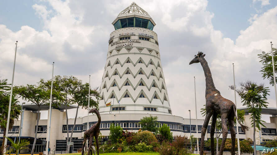 FILE - The control tower is seen at Zimbabwe's main international airport in Harare, Nov. 9, 2017. Earlier this week, authorities arrested five activists at the airport.