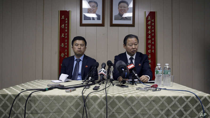 Ambassador of the Permanent Mission of the Democratic People's Republic of Korea to the United Nations Jang Il Hun, right, is joined by councilor Kwon Jong Gun as he speaks during a new conference, July 28, 2015,  at the DPRK mission in New York.