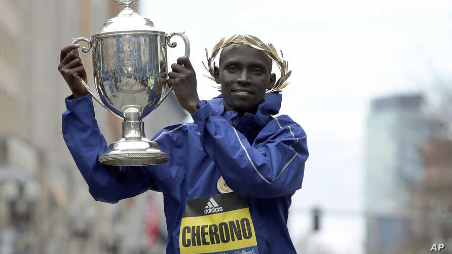Lawrence Cherono, of Kenya, holds the trophy after winning the 123rd Boston Marathon, on April 15, 2019, in Boston.