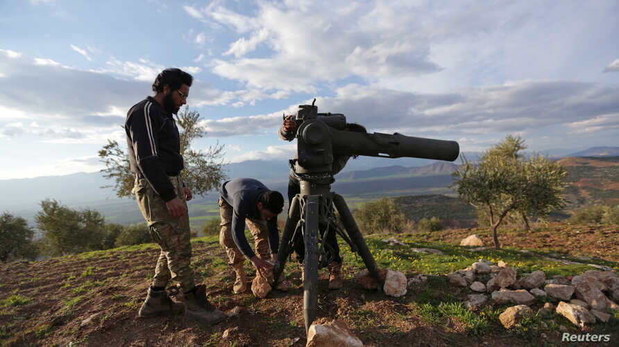 FILE - Turkish-backed Free Syrian Army fighters prepare a TOW anti-tank missile north of Afrin, Syria, Feb. 18, 2018.