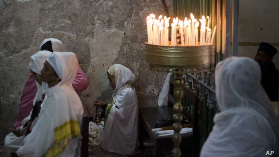 Ethiopian Christians pray at Deir El Sultan outside the Church of the Holy Sepulchre, traditionally believed by many to be the site of the crucifixion of Jesus Christ, during the Holy Week procession in Jerusalem's old city, April 20, 2019.