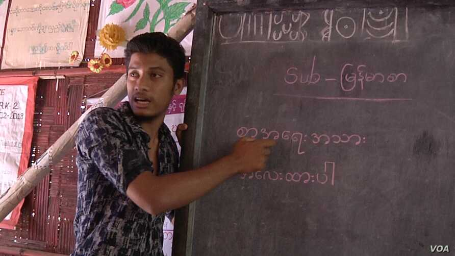Shamsuddin, a Rohingya refugee himself, teaches Burmese language to Rohingya children. Like many of the teachers in the refugee camps he has only finished high school.