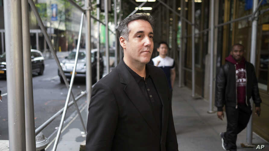 Michael Cohen, President Donald Trump's former personal attorney, waits on a street corner before going to his New York City apartment, May 4, 2019, in New York.