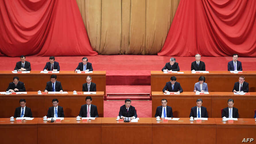 China's President Xi Jinping (C) speaks at a ceremony marking the centennial of the May Fourth Movement, a landmark student protest against colonialism and imperialism, in Beijing's Great Hall of the People, April 30, 2019.