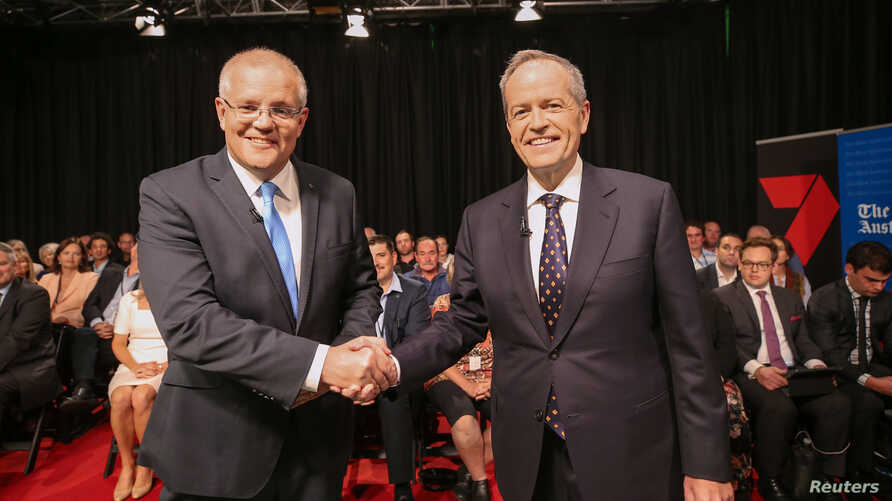 Australian Prime Minister Scott Morrison and Opposition Leader Bill Shorten shake hands before the first leaders forum at the Seven West Media Studios in Perth, Australia, April 29, 2019. (AAP Image/ The West Australian Pool/via Reuters)