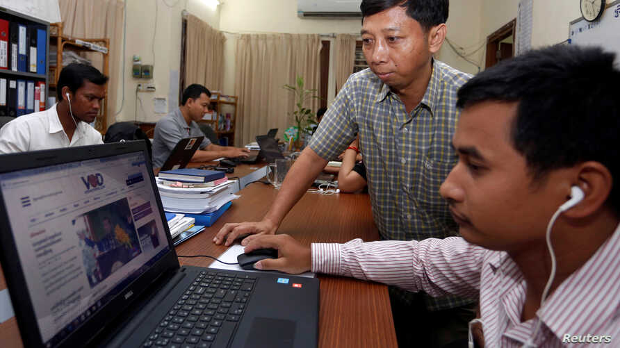 FILE - Voice of Democracy's news website is seen on a computer screen in an office in Phnom Penh, Cambodia, Aug. 31, 2017.