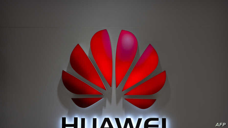 FILE - In this July 4, 2018, photo, the Huawei logo is seen at a Huawei store at a shopping mall in Beijing. Chinese-owned telecommunications giant Huawei has been blocked from rolling out Australia's 5G network due to security concerns.