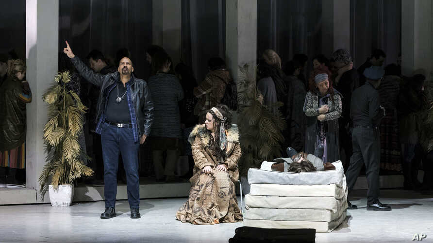 """FILE - Actors perform a scene during the rehearsal of George Gershwin's opera """"Porgy and Bess"""" at the Erkel Theatre in Budapest, Hungary, Jan. 27, 2018."""