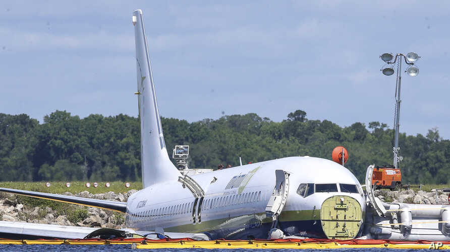 A Boeing 737 arriving, May 3, 2019, at Naval Air Station Jacksonville from Naval Station Guantanamo Bay, Cuba, with 136 passengers and seven aircrew slid off the runway Friday night into the St. Johns River, a NAS Jacksonville news release said.