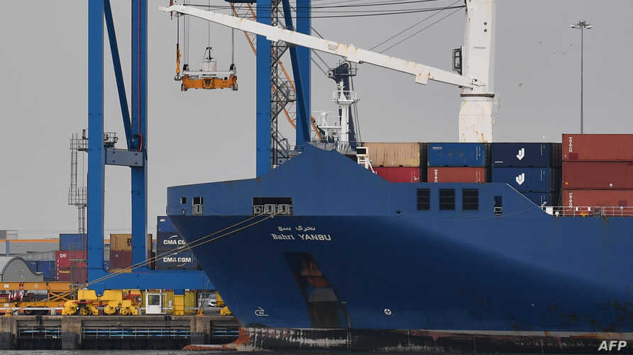 The cargo ship Bahri-Yanbu is seen moored at Tilbury Docks at the Port of Tilbury in Essex as seen from the village of Swanscombe in Kent, east of London, May 7, 2019. French parliamentarians called on the French government to clarify the intended ca...