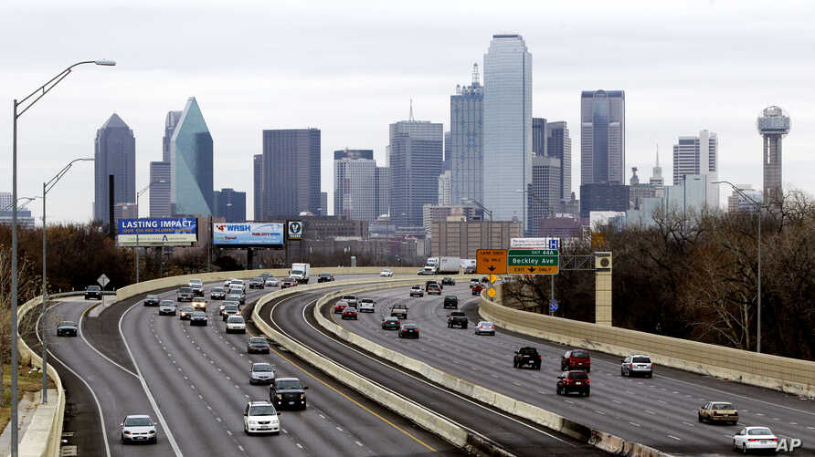 FILE - A view of Texas highway IH-30 traffic with the Dallas skyline.