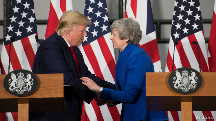 Britain's Prime Minister Theresa May and U.S. President Donald Trump attend a joint news conference at the Foreign & Commonwealth Office, in London, Britain, June 4, 2019.
