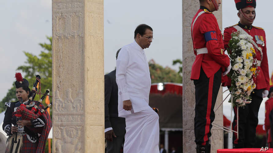 Sri Lankan president Maithripala Sirisena arrives to place a wreath at the fallen heroes memorial during the tenth anniversary of Sri Lanka's civil war victory in Colombo, Sri Lanka, May 19, 2019.