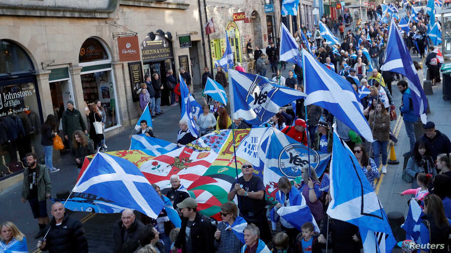 """FILE - """"All Under One Banner"""" pro-independence protesters take part in a march and rally in Edinburgh, Scotland, Oct. 6, 2018."""