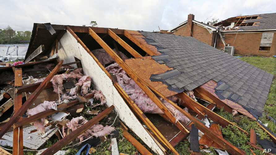 A roof a home that was blown off a home rests on the ground in Hamilton, Miss., after after a deadly storm moved through the area, April 14, 2019.