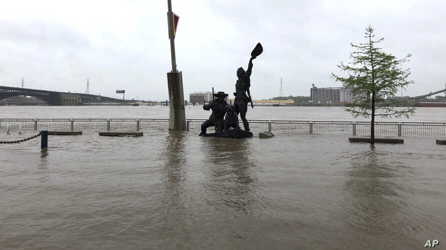 A statue of explorers Lewis and Clark is surrounded by floodwater along the St. Louis riverfront, May 2, 3019.