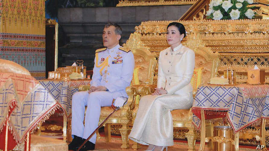 In this May 2, 2019, photo released by Bureau of the Thailand Royal Household, Thailand's King Maha Vajiralongkorn, left, and Queen Suthida sit at Bangkok City Pollar Shrine in Bangkok, Thailand.