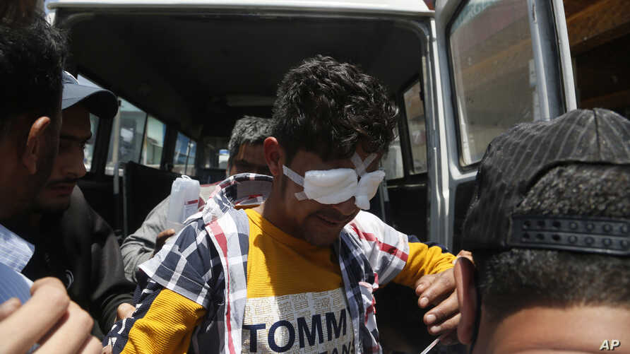 A Kashmiri man whose eyes were injured with pellets during a clash with Indian security forces in south Kashmir arrives for treatment at a hospital in Srinagar, India, May 29, 2019.