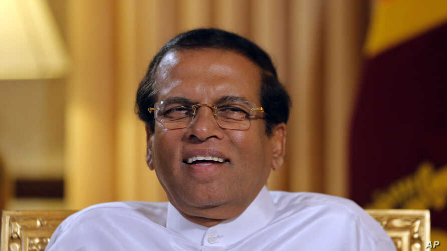 Sri Lankan President Maithripala Sirisena smiles during an interview with the Associated Press at his residence in Colombo, Sri Lanka, Tuesday, May 7, 2019.