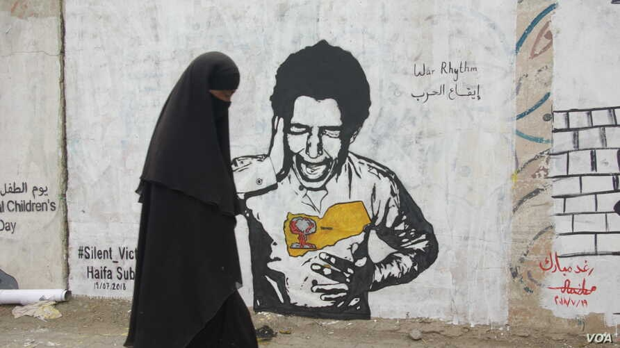 This mural in Sanaa drawn by Yemeni artist Haifa Subay depicts a boy screaming in pain, with a map of Yemen on his chest. Subay wants to shed light on Yemenis' plight by drawing her works in public spaces.